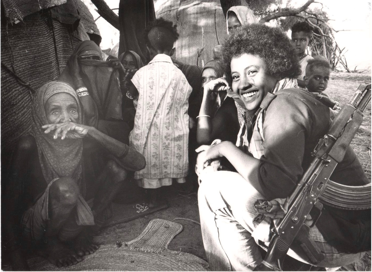 Eritrean woman fighter chatting with women in Ado Okut village in Barka