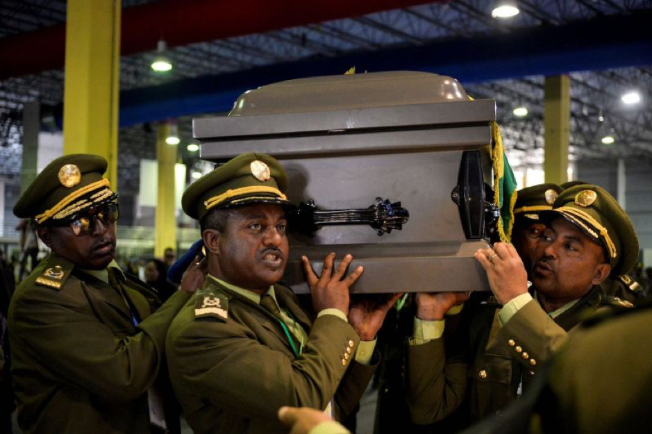 Members of the army carry a coffin covered with the Ethiopian flag in Addis Ababa on June 25, in preparation for the funeral service of the Chief of Staff of the Ethiopian National Defense Force, Seare Mekonnen, who was assassinated on June 22. MICHAEL TEWELDE/AFP/Getty Images